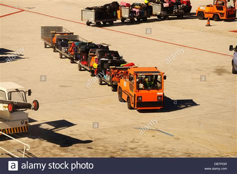 Baggage Truck Airport Stock Photos & Baggage Truck Airport
