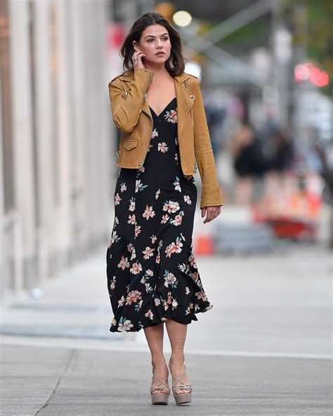 Danielle Campbell seen wearing a tan leather jacket over a